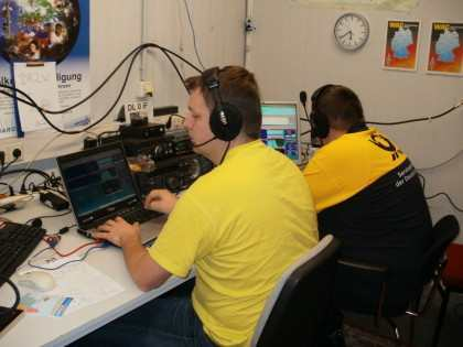 Ewald and Mathias sitting on the red button